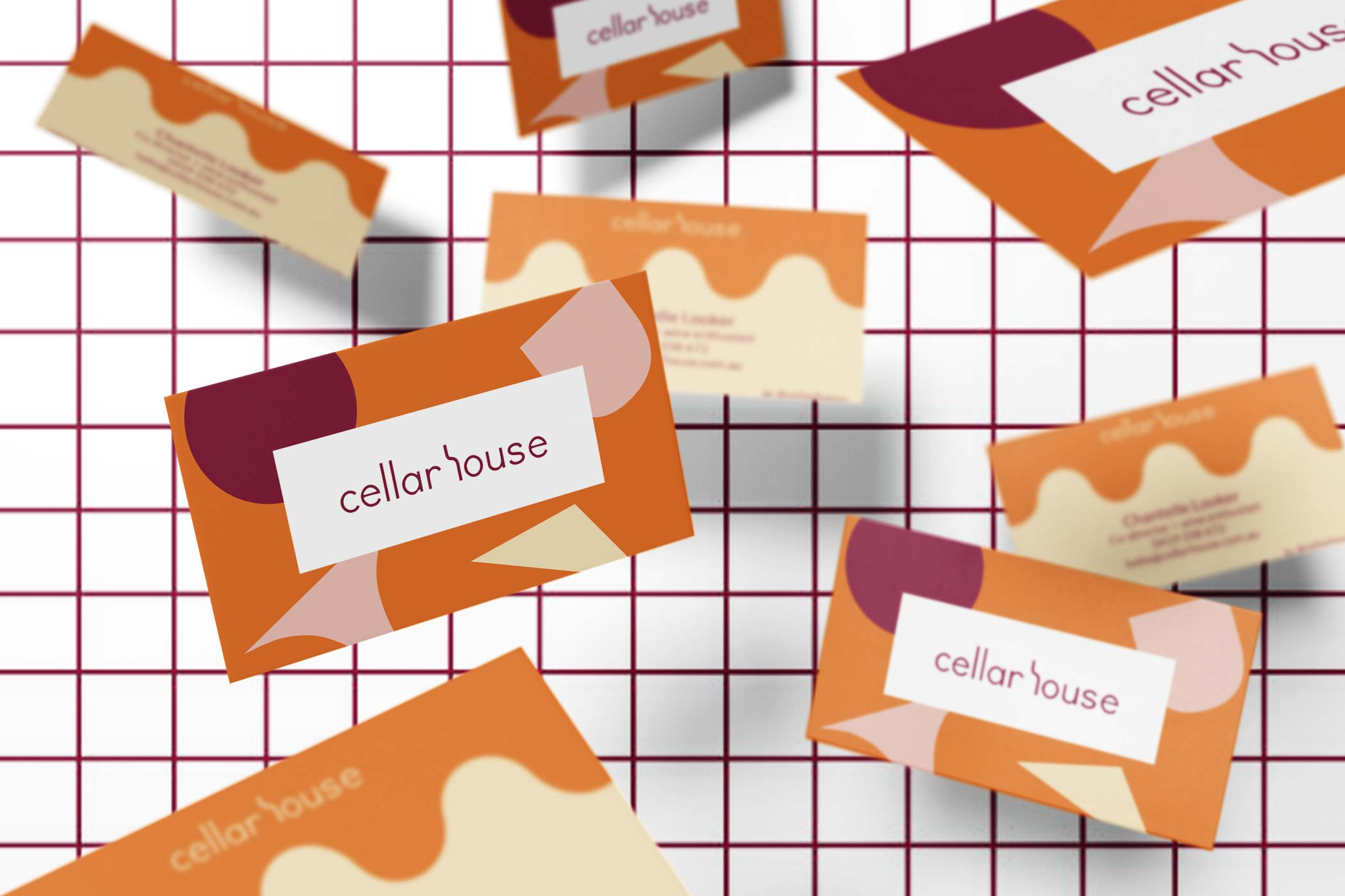 Floating business cards for Cellar House on check background
