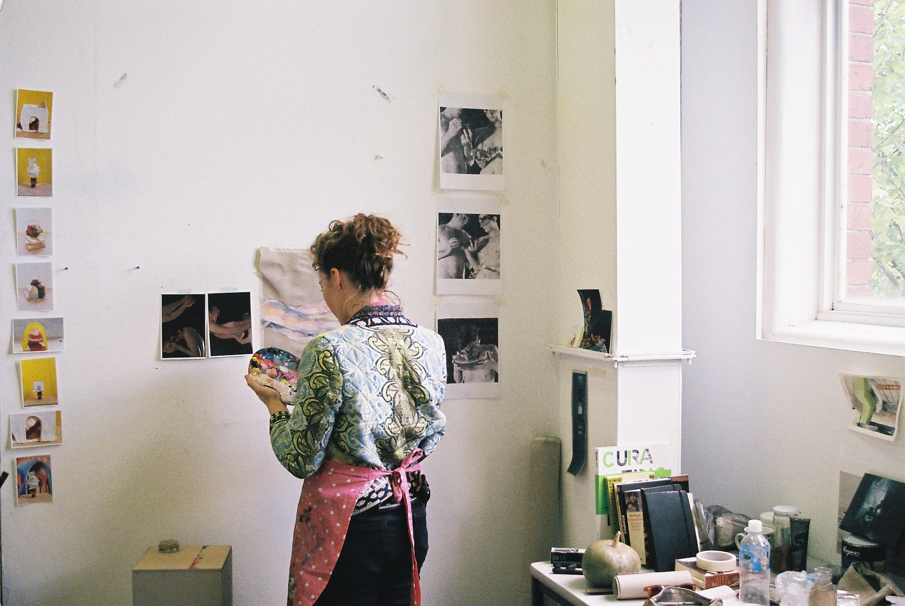 Photo of Candice painting in a studio