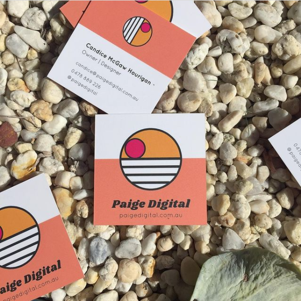 Paige Digital business cards on white stones